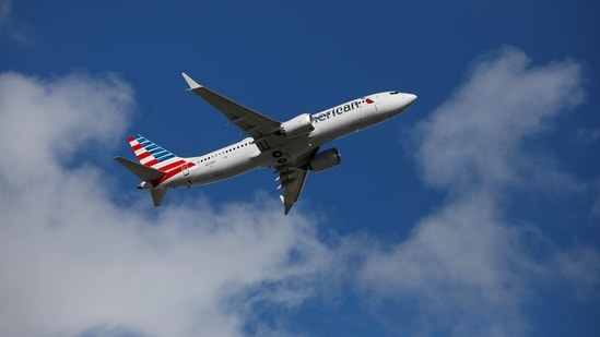 Falling infections and hospitalizations and rising vaccinations have spurred demand after a blow early this year when the US required negative coronavirus tests for international travelers, American Airlines said. In picture - American Airlines flight 718.(Reuters)