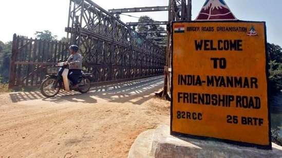 A man rides his motorised two-wheeler across the Indo-Myanmar border bridge at the border town of Moreh, in the northeastern Indian state of Manipur, on January 25, 2012. (Reuters)