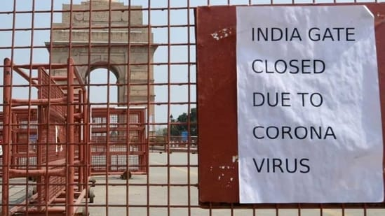 A public notice hangs outside India Gate during Janta Curfew proposed by Prime Minister Narendra Modi -- to prevent the spread of coronavirus, at Humanyun Road, in New Delhi, India, on Sunday, March 22, 2020.(Sushil Kumar/HT PHOTO)