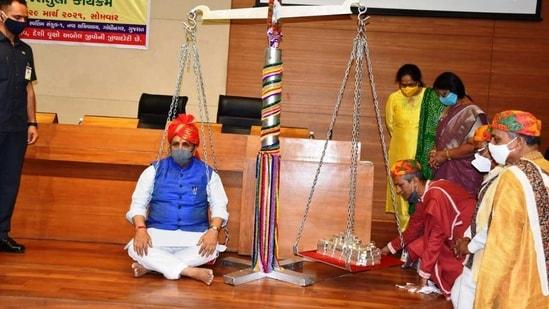 Gujarat chief minister Vijay Rupani weighed against 85 kilograms of silver. (Image via Facebook )