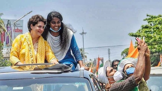 Congress supporter clicks a selfie with party leader Priyanka Gandhi Vadra election campaigning at Karunagappally in Kollam district on Tuesday.