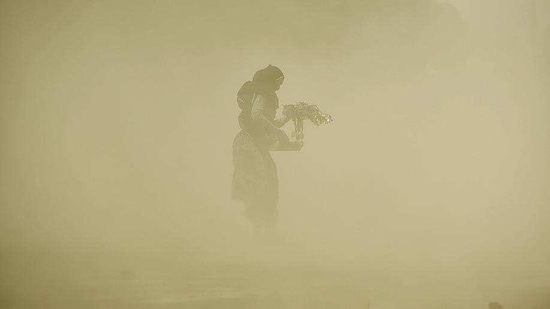 A dust storm blows through the Rajpath lawns near India Gate on Tuesday.(HT Photo)