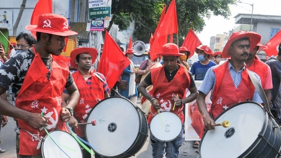 Kolkata: Supporters of CPI(M) MLA and Sonjukta Morcha nominated candidate from Jadavpur Assembly constituency Sujan Chakraborty play drums, during his door-to-door election campaign for the West Bengal assembly polls, in Kolkata, Tuesday, March 30, 2021. (PTI Photo)(PTI03_30_2021_000035A)(PTI)