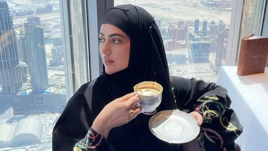 Sana Khan enjoying gold-plated coffee at Burj Khalifa.