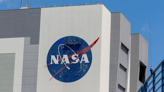 Workers pressure wash the logo of NASA on the Vehicle Assembly Building at the Kennedy Space Center in Cape Canaveral, Florida. (REUTERS)