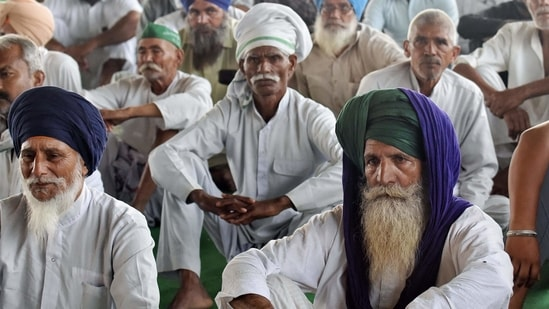 Farmers sitting on a demonstration during the ongoing farmers' protest at the Delhi-Ghazipur border, in New Delhi on Thursday. (ANI Photo)