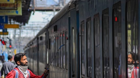 A worker a train in Amritsar.(PTI)