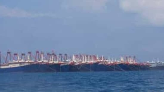 In this photo provided Sunday, March 21, 2021, by the Philippine Coast Guard/National Task Force-West Philippine Sea, some of the 220 Chinese vessels are seen moored at Whitsun Reef, South China Sea on March 7, 2021. The Philippine government expressed concern after spotting more than 200 Chinese fishing vessels it believed were crewed by militias at a reef claimed by both countries in the South China Sea, but it did not immediately lodge a protest. (Philippine Coast Guard/National Task Force-West Philippine Sea via AP)(AP)