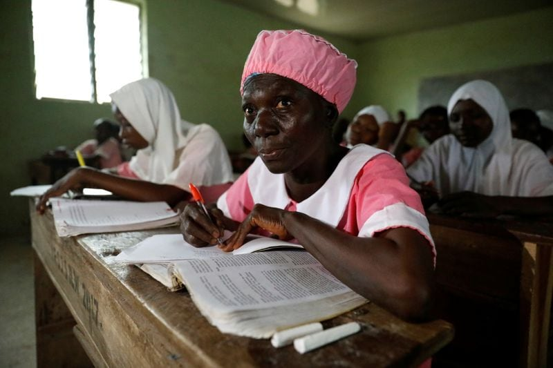 Shade Ajayi, 50, takes notes during class at Ilorin High School in Ilorin, Kwara State.  (REUTERS)