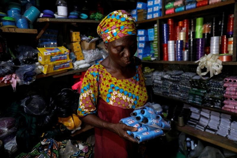 Shade Ajayi, 50, buys thread for her bag-making from a store in Ilorin, Kwara State.  (REUTERS)