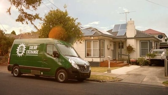 A VB Solar Exchange van is seen in front of a house with solar panels.(VICTORIA BITTER via REUTERS)