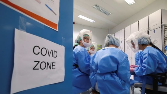 Members of the medical personnel take part in a meeting at the intensive care unit for patients suffering from the coronavirus disease (Covid-19) at ZNA Stuivenberg hospital in Antwerp, Belgium, March 31, 2021. (Reuters)