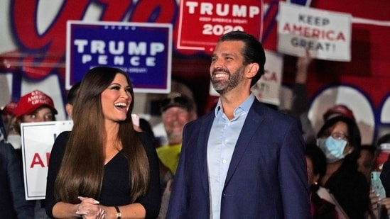 Donald Trump Jr., right, smiles along with his girlfriend Kimberly Guilfoyle prior to a news conference.(AP)