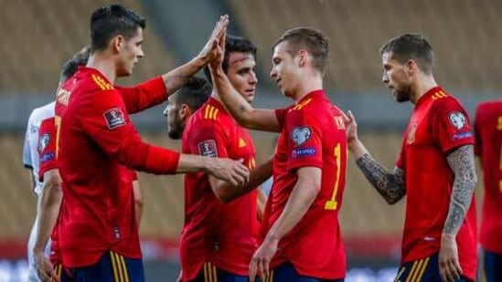 Spain players celebrate after scoring the opening goal during the World Cup 2022 Group B qualifying round soccer match between Spain and Kosovo at La Cartuja stadium in Seville, Spain, Wednesday March 31, 2021.(AP)