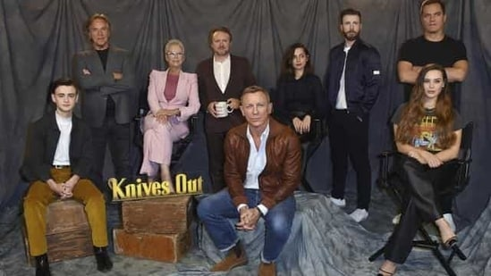 Jaeden Martell, from left, Don Johnson, Jamie Lee Curtis, Rian Johnson, Ana de Armas, Chris Evans, Michael Shannon and Katherine Langford attend the Knives Out photo call at the Four Seasons Hotel on November 15, 2019.(AP)