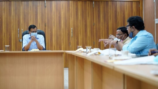 Delhi CM Arvind Kejriwal chairing an emergency meeting in the wake of a rise in Covid-19 cases, at his residence in New Delhi, (HT photo)