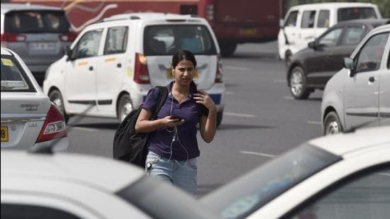 File photo: A commuter looking for app-based cab. (Sanjeev Verma/HT PHOTO)