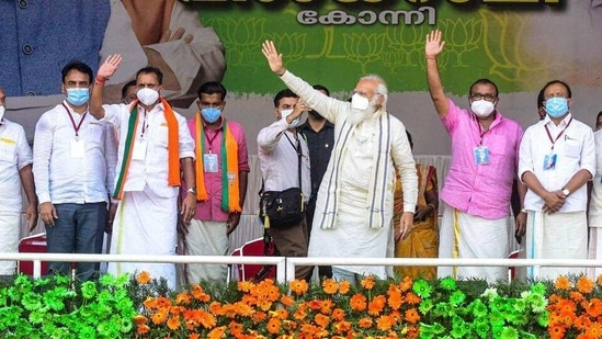 Prime Minister Narendra Modi waves to the crowd during an election rally for the Kerala assembly polls at Konni in Pathanamthitta district on Friday. (PTI)