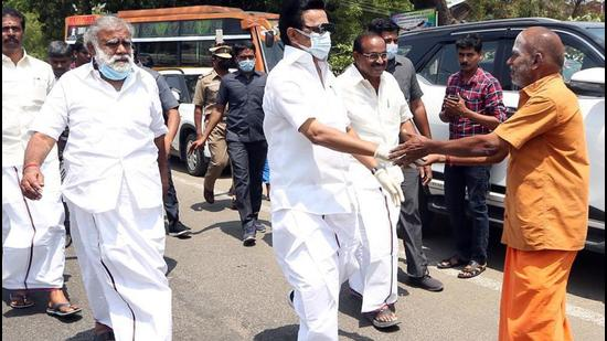 DMK chief MK Stalin interacts with people during a door-to-door campaign in Madurai on Wednesday, March 31. (ANI)