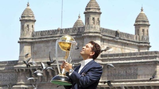 Sachin Tendulkar poses with the trophy after winning the Cricket World Cup final match between Sri Lanka and India in 2011.(AP)