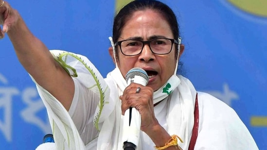 """The TMC supremo also urged Hindus to be on the guard against the BJP's attempts to """"instigate communal clashes"""" and called upon them to chase away outsiders sent to foment trouble in their respective localities.(ANI)"""
