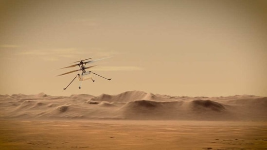 An artist's concept of Nasa's Ingenuity Mars Helicopter flying through the Red Planet's skies.(NASA/JPL-Caltech)