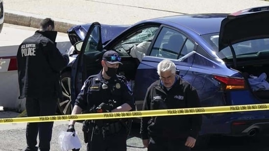 US Capitol Police officers near a car that crashed into a barrier on Capitol Hill in Washington, on Friday. (AP)