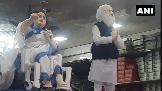 The image shows 'sweet' statuettes of PM Narendra Modi and CM Mamata Banerjee.(Twitter/@ANI)