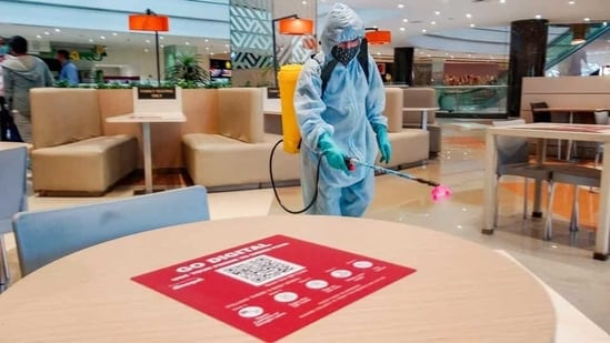 A worker sanitizes a hotel ahead of its reopening, Unlock 5, amid the coronavirus pandemic, in Pune. (PTI)