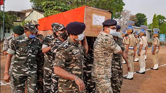 CRPF personnel carry the coffin of a paramilitary soldier who lost his life in an encounter with Maoists in Bijapur district of Chhattisgarh. (PTI)