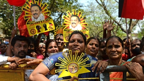 Members of Dravida Munnetra Kazhagam (DMK) hold placards with portrait of party president MK Stalin during a rally ahead of the Tamil Nadu state legislative assembly elections in Chennai.(AFP)
