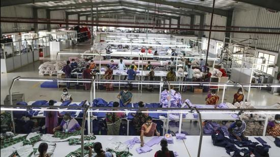 Employees handle garments on the cutting division production line at the CBC Fashions Pvt. factory in Tiruppur, Tamil Nadu. (Bloomberg)