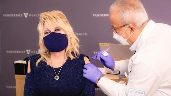 Seen on the likes of Dolly Parton, who recently opted for a vaccine-ready, sparkly blue knit top with cutout shoulder detailing as she got her first shot of the Moderna vaccine, the '90s style has made a comeback like never before! (Photo: Instagram/DollyParton)