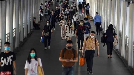 People wearing face masks as a measure to prevent the spread of the coronavirus disease (Covid-19) are seen at a train station in Bangkok, Thailand.(Reuters)