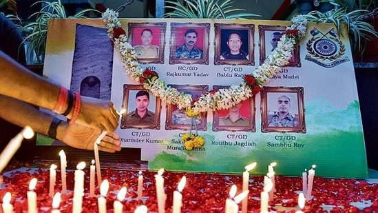 People light candles to pay tribute to the personnel who were killed in the Chhattisgarh gunfight, in Bengaluru on Monday.(PTI)