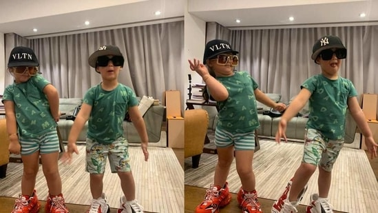 Karan Johar's children Yash and Roohi pose in his shoes.
