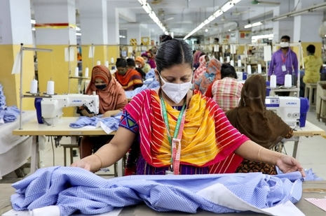 A woman works in a garment factory in Dhaka. (REUTERS)