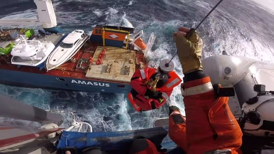 Head cam footage of a search and rescue member hoisting a crew member from Dutch cargo ship Eemslift Hendrika during an evacuation in stormy weather off the coast of Norway in the North Sea. (REUTERS )
