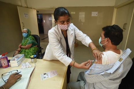 A health worker administers a Covid-19 vaccine, at Sector 30 District Hospital, in Noida. (Sunil Ghosh / Hindustan Times)