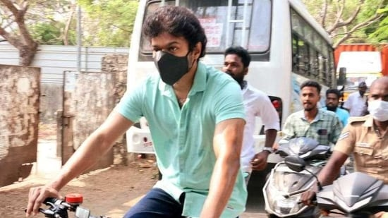 Actor Vijay rides a bicycle to the polling booth as he arrives to cast his vote during the assembly elections in Chennai on Tuesday. (ANI Photo)