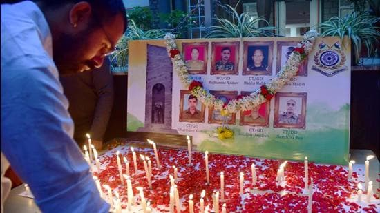 Members of National Students Union of India (NSUI) light candles to pay tribute to soldiers, who were killed in an encounter with Naxals in Chhattisgarh. (PTI)