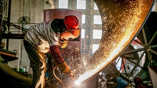Sparks fly up as a worker produces engineering equipment for export at a factory in Nantong in China's eastern Jiangsu province. (AFP)
