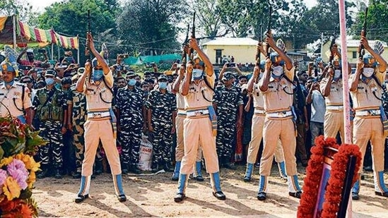 Security personnel pay tribute to a CRPF jawan during his funeral ceremony at Dharmanagar, Tripura, on Tuesday. (PTI Photo)