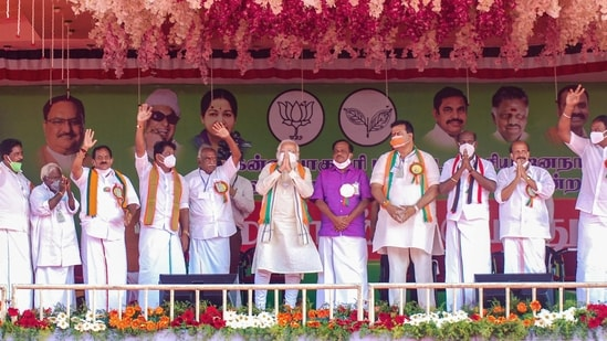 Prime Minister Narendra Modi campaigns for the BJP candidate Pon Radhakrishnan (immediate right to Modi) in Kanyakumari on April 2, 2021.(PTI)