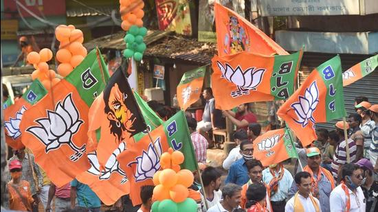 BJP activists with party flags in Kolkata. (PTI)