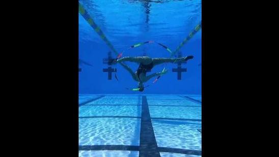 The image shows Kristina Makushenko doing gymnastics underwater.(Instagram/@kristimakusha)