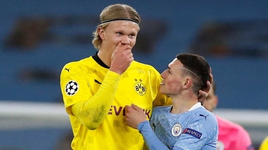 Champions League - Quarter Final - First Leg - Manchester City v Borussia Dortmund - Etihad Stadium, Manchester, Britain - April 6, 2021 Borussia Dortmund's Erling Braut Haaland with Manchester City's Phil Foden after the match(REUTERS)