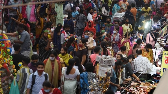 Heavy rush of shoppers at a weekly market with some people not wearing face masks, in Pandav Nagar, New Delhi, India, on Wednesday, April 7, 2021. (Photo by Raj K Raj/ Hindustan Times)