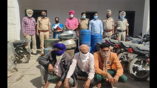 The three accused from Fatehwal village in Ajnala sub division of Amritsar district in police custody on Wednesday. They were manufacturing illicit liquor in their houses. (HT Photo)