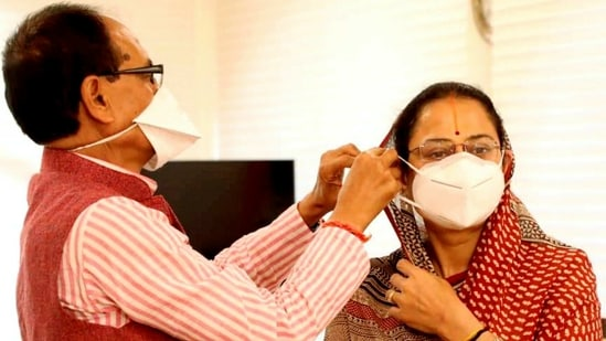 Madhya Pradesh chief minister Shivraj Singh Chouhan with wife Sadhna Singh during a Covid-19 awareness campaign, in Bhopal on Monday.(PTI Photo)